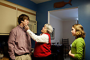 Linda Groeber, 67, touches her grandson Evan Brown, 13, on the cheek while inquiring about school while her granddaughter, Annie Brown, 9 looks on in Lutherville-Timonium, Maryland on Wednesday, January 13, 2010. As she ages Linda has relied more on her daughters Tracey Brown and Annie Groeber to help with day-to-day tasks.