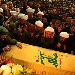 Hezbollah number two, Naim Qassem, center, hands up, prays over the coffin of slain militant commander Imad Mugniyeh in Beirut, Lebanon on Feb. 14, 2008. Imad Mugniyeh was killed in a mysterious car bombing in Damascus, Syria. Mugniyeh a.k.a. Hajj Radwan, was among the most feared terror operatives in the world.