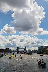 London Bridge, London, June 15th 2016. A flotilla of fishing boats led by UKIP's Nigel Farage heads through Tower Bridge in protest against the EU's Common Fisheries Policy and in support of Britain leaving the EU. PICTURED: Sparkling weather greets the protesting fishermen on the River Thames.