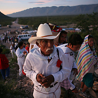 Followers of Nino Fidencio, a curandero or healer who passed away in the 1938, arrive to an early morning prayer and healing session on top of a hill just outside of Espinazo, Mexico on October 18, 2006. Followers of Nino Fidencio believe that his spirit can posses other healers, who once possessed speak in a child like voice and perform a variety of medical cures on their followers. His believers, an estimated 20,000, gather in his hometown for a three-day festival twice a year in March and October. (Photo/Scott Dalton)