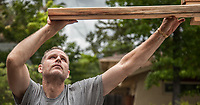 Rex Heywood unloads lumber at a construction site in Calistoga