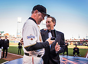 SAN FRANCISCO, CA - APRIL 18:  CEO, Larry Baer, of the San Francisco Giants presents Manager, Bruce Bochy #15 with his 2014 World Series ring during the San Francisco Giants World Series ring ceremony at AT&T Park on Saturday, April 18 2015 in San Francisco, California. Photo by Jean Fruth