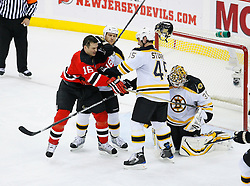 Dec 23, 2008; Newark, NJ, USA; New Jersey Devils center Bobby Holik (16) and Boston Bruins defenseman Mark Stuart (45) battle in front of Boston Bruins goalie Tim Thomas (30) during the second period at the Prudential Center.