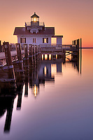 A calm early morning picture of Roanoke marshes lighthouse on the Manteo waterfront.