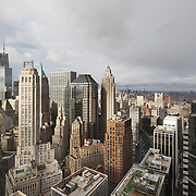 Manhattan stretches on, seemingly forever, in this image of Wall Street from above, shot from 55 Water Street.