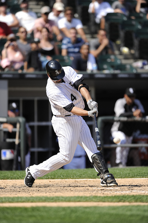 CHICAGO - JULY 06:  Paul Konerko #14 of Chicago White Sox bats against the Kansas City Royals on July 6, 2011 at U.S. Cellular Field in Chicago, Illinois.  The Royals defeated the White Sox 4-1.  (Photo by Ron Vesely)  Subject: Paul Konerko