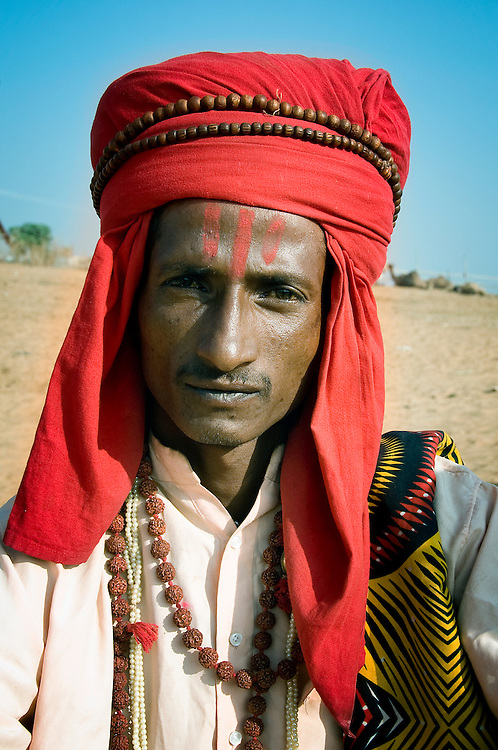 Traditionally, Kalbeliya are snake charmers. At the Pushkar Camel Fair, they walk around dressed up, and beg for extra income from villagers and foreign tourists alike.