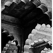 Black and white detail of architecture at the Red Fort in Delhi, India.