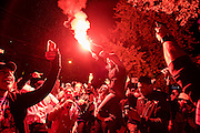 Fans use a flare to celebrate the Chicago Cubs first World Series win since 1908 in Wrigleyville.