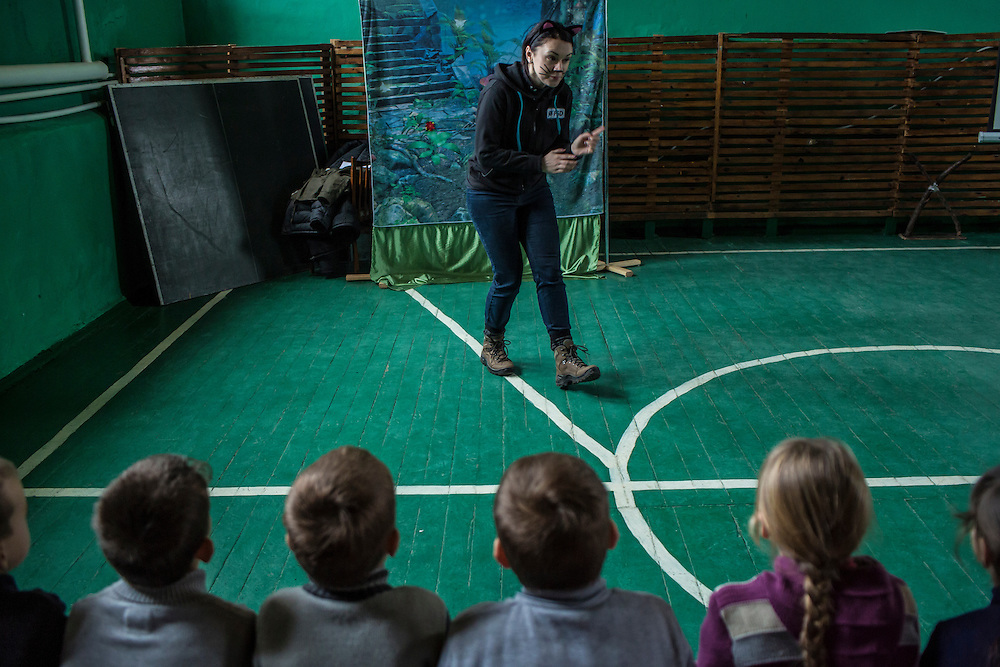 Olena Rozvadovska of the Swiss Foundation on Mine Action gives a mine awareness training at School #21 on Tuesday, December 15, 2015 in Scherbynivka, Ukraine.