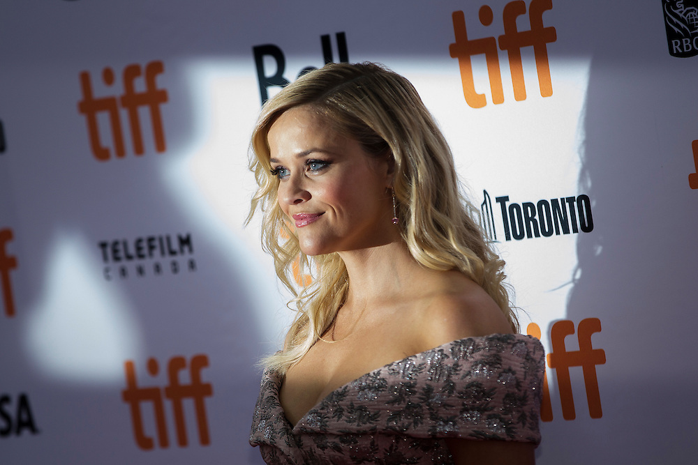Reese Witherspoon poses for photographs at the premiere of Sing at the Toronto International Film Festival in Toronto, Ontario, September 11, 2016.