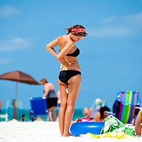 SARASOTA, FL -- June 14, 2011 -- Devin Bledsoe, 20, of Memphis, Tenn, applies sunscreen as she takes in the sun while on vacation at Siesta Public Beach in Sarasota, Fla., on Tuesday, June 14, 2011.