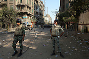 Egyptian soldiers stand in a no-man's land between protestors and riot police to try to create and hold a buffer zone between the two sides during clashes November 22, 2011 near Tahrir square in central Cairo, Egypt. The effort broke down several minutes later as the two sides resumed their clashes. Thousands of protestors demanding the military cede power to a civilian government authority clashed with Egyptian security forces for a fourth straight day in Cairo, with hundreds injured and at least 29 protestors killed so far.  (Photo by Scott Nelson)
