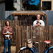 Landscape architects Catherine Chang and Christopher Andrews pose for a portrait in front of a chicken coop they designed for Pizzaiolo restaurant in Oakland. The resident chickens, all exotic heirloom breeds, lay eggs that are served to patrons. <br />