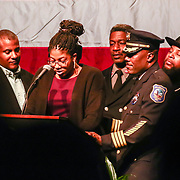 Family members of Wilmington firefighter Ardythe Hope, surrounds daughters Ardavia Lee as she gives remarks about her mother during Senior Firefighter Ardythe Hope funeral services Sat, Dec. 11, 2016, at The Chase Center On The River Front in Wilmington, Delaware. Photo By Saquan Stimpson<br /> <br /> Wilmington Senior Firefighter Ardythe Hope died Dec. 1 from injuries suffered battling a fire on September 24th that was ruled arson.  <br /> <br /> She'd been in the hospital ever since with burns over 70 percent of her body.