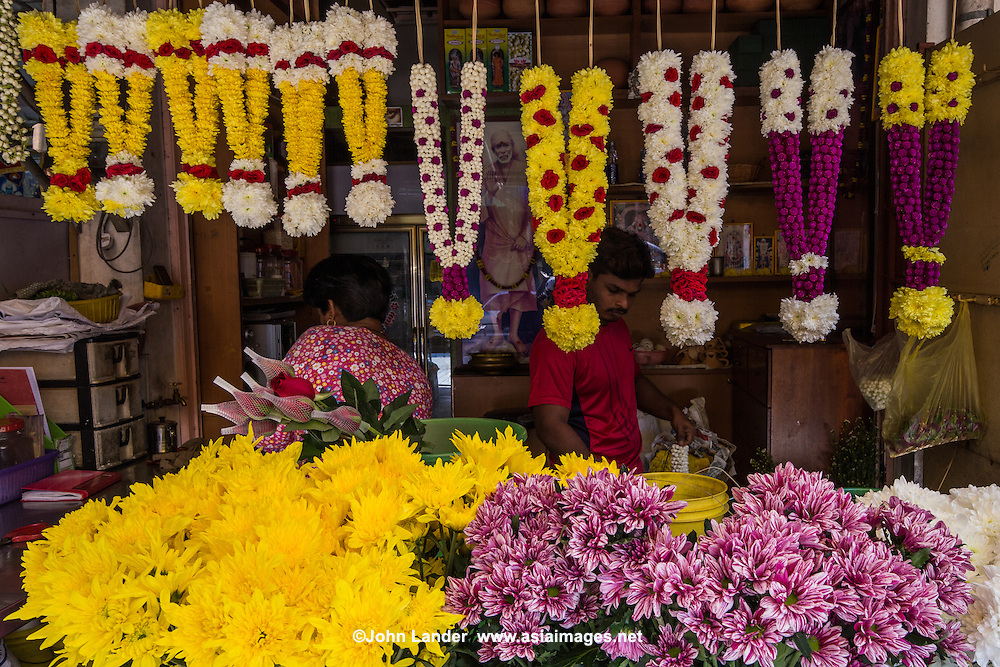 Devotional flower arrangements are a special way to show devotion for Indian gods, whether they be Hindu or Buddhist.  These devotional floral pots can be seen everywhere in people's homes, in hotel lobbies and restaurant entrances.