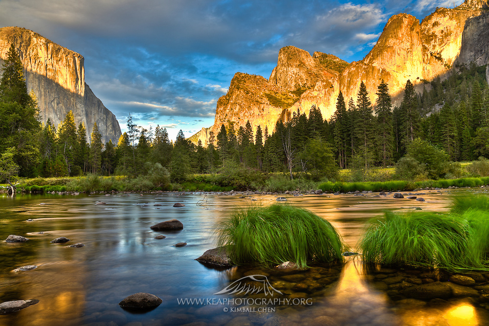 A beautiful golden sunset draped over Yosemite Valley, along the banks of the Merced River.