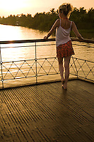 Mekong River Sunset on deck of Le Bassac  - a refubished rice barge with luxe amenities that is now used to transport visitors through the Mekong Delta region of Vietnam.