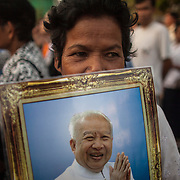 Cambodian mourners hold portraits of late former Cambodian King Norodom Sihanouk as they wait outside the Royal Palce in Phnom Penh, Cambodia, 01 February 2013. The Royal cremation ceremony for former Cambodian King Norodom Sihanouk is scheduled on 04 February 2013, after he died on 15 October 2012 in Beijing, China, at the age of 89.