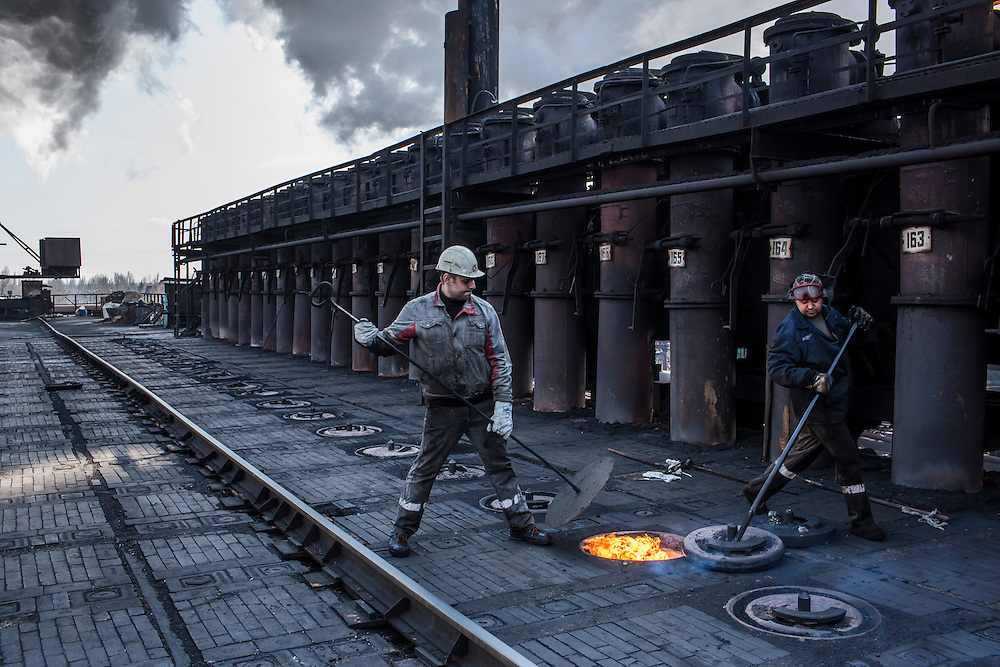 AVDIIVKA, UKRAINE - MARCH 18, 2015: Workers at the Avdiivka Coke and Steel plant tend to the furnaces in Avdiivka, Ukraine. CREDIT: Brendan Hoffman for The New York Times