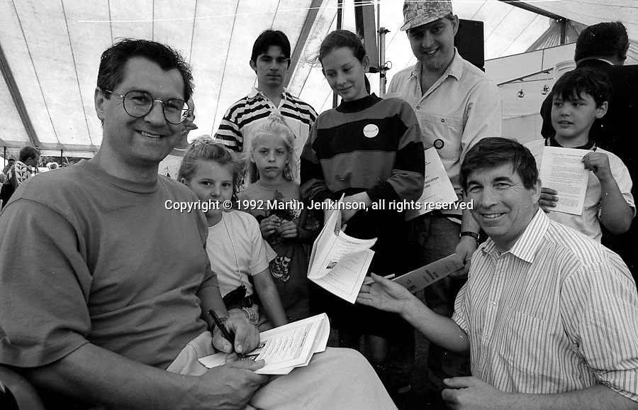 """TV actors from """"The Bill"""", Colin Tarrant (Inspector Andrew Munroe}  and Peter Ellis (Chief Supt Charles Brownlow) sign autographs at the 1992 Yorkshire Miners Gala, Barnsley."""