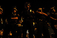 New York City police watch as demonstrators against U.S. President George Bush rally near the site of the Republican National Convention during the President's party nomination September 2, 2004 in New York City.