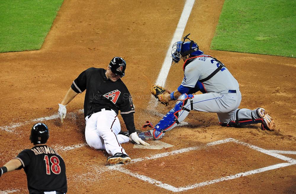 Aug. 6 2011; Phoenix, AZ, USA; Arizona Diamondbacks infielder Paul Goldschmidt (44) scores against Los Angeles Dodgers catcher Rod Barajas (28) during the second inning against at Chase Field. Mandatory Credit: Jennifer Stewart-US PRESSWIRE.