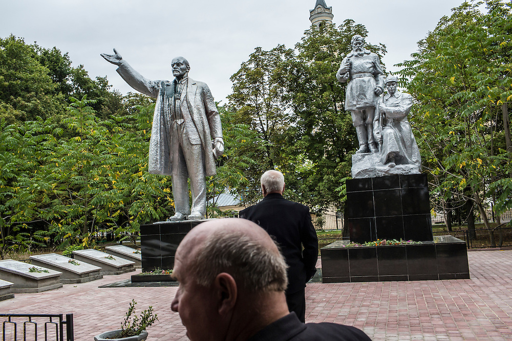 SEMYONOVKA, UKRAINE - SEPTEMBER 13, 2015: Ivan Kovalenko, 69, foreground, and Ivan M. Papchenko, 67, the secretary of the local Communist party, near a reconstituted statue of Vladimir I. Lenin in Semyonovka, Ukraine. The statue, which was taken down from the town square in the immediate aftermath of the collapse of the government of President Viktor Yanukovych in February 2014, was erected again in a new, more discreet, location in a park two months later based in part by a petition to the city council submitted by the local Communist party. A new decommunization law has stirred criticism as being a diversion from more pressing issues of war and the economy. CREDIT: Brendan Hoffman for The New York Times
