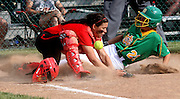 Maddie Wirth of Newark Catholic slides safety into home base at the regional semi finals they won 13-1. Saturday they advance to the regional finals.