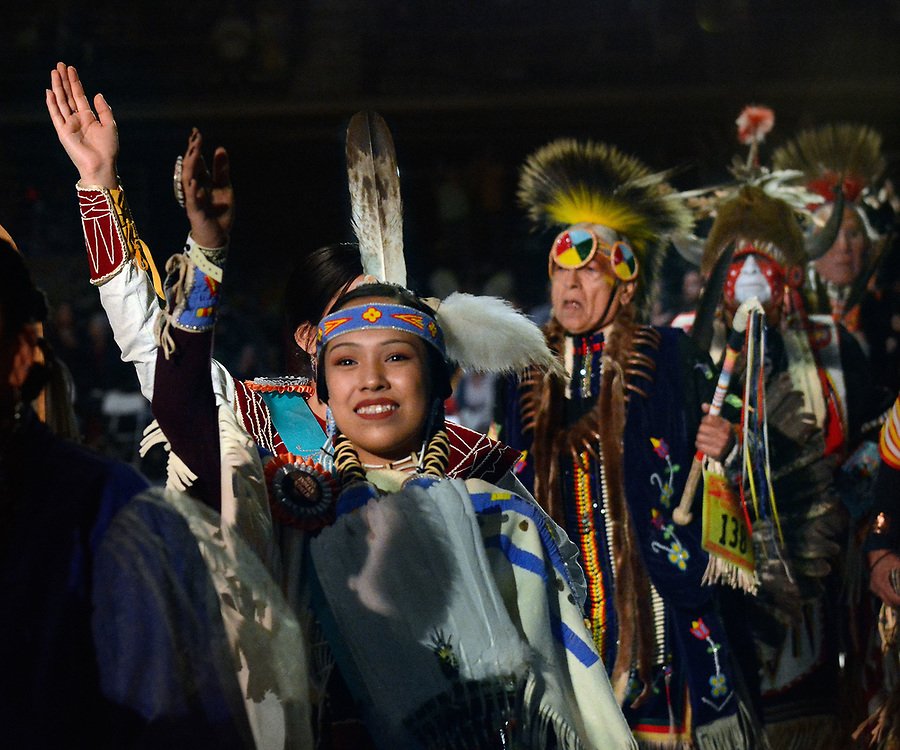 jt042817k/a sec/jim thompson/ A young lady waves to the crowd as she enters the floor of Tingley Coliseum for the Grand Entrance for the start of the 2017 Gathering of Nations Pow-Pow.  Friday April 28, 2017. (Jim Thompson/Albuquerque Journal)