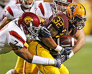 University of Southern California played Arizona State University in Tempe, Arizona on November 7, 2009.  USC won 14 to 9.  ASU #32 Jamal Miles is brought down by USC #7 TJ McDonald.