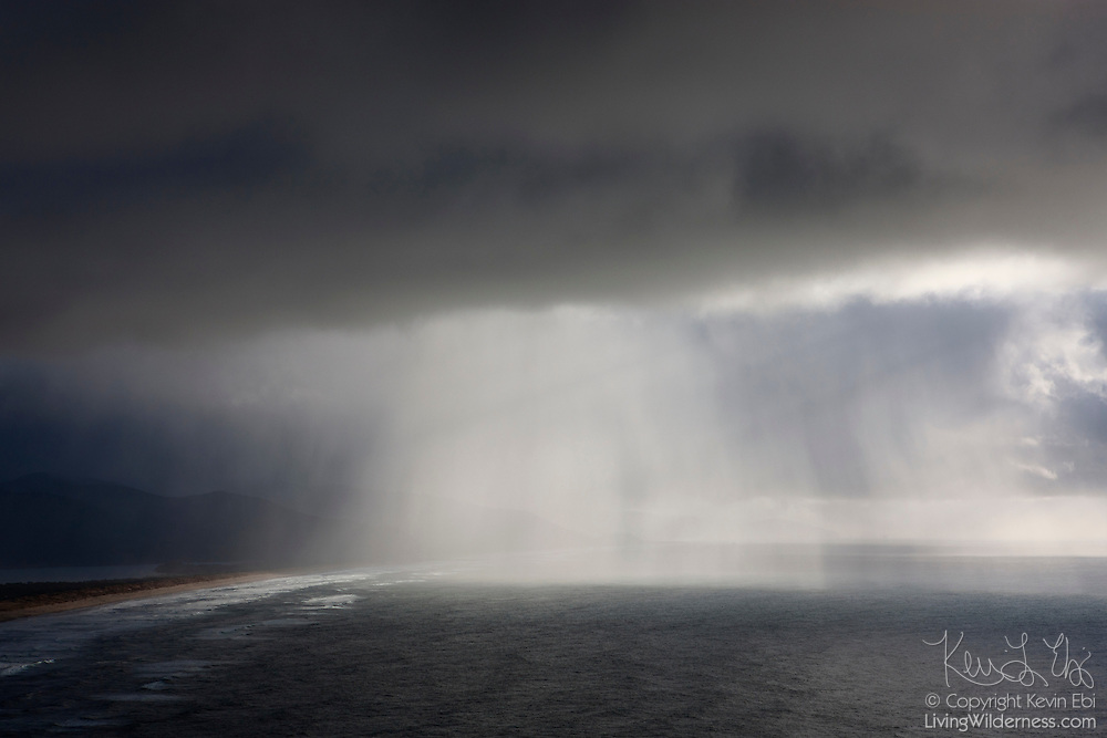 A heavy rain storm passes over the Pacific Ocean near Manzanita, Oregon.