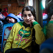 Maram, 13, a refugee from Daraa, Syria, waits to depart the Presevo train station for the Croatian border where she and her family will continue on to Germany. Presevo, Serbia, January 11, 2016.<br /> <br /> Maram said, &quot;The people in Greece were so nice to us, but the journey has been very exhausting, and the boats were very scary. Now we are going to Germany, and we will study and learn the language. And we will stay there and hope for a happy life.&quot; Maram and her family are among the 67,415 refugees (UNHCR statistic) who landed in Greece in January 2016. <br /> <br /> On assignment for Mercy Corps, I documented refugees crossing through Serbia in January 2016.