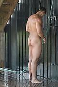 sexy bodybuilder in an outdoor shower