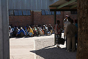 Illegal immigrants from Zimbabwe caught fleeing a life of opporession and hunger in Zimbabwe in search of better prospects in South Africa...The South African military patrol the border day and night arresting men, women and children crossing illegally through the fenced international boundary dividing Zimbabwe and South Africa...The illegal immigrants are detained at a 'holding facility' inside a military base serveral kilometers outside the border town of Messina. Basic details such as names are recorded, they are offered meagre rations of bread and a soda drink before being loaded on to police vehicles and returned to the border for repatriation in Zimbabwe. Many will return to the border in the coming days to pursue a new life in South Africa.