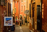 A street in picturesque Roussillon, France.<br /> The color of the walls comes from a sud extracted from the surrounding mountains; it frequently appears on Roussilon's old buildings.