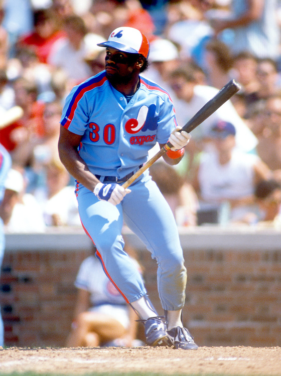 CHICAGO - JUNE 1989:  Tim Raines of the Montreal Expos attempts to bunt during an MLB game versus the Chicago Cubs at Wrigley Field in Chicago, Illinois.  Raines played for the Expos from 1979-1990. (Photo by Ron Vesely)  Subject:  Tim Raines