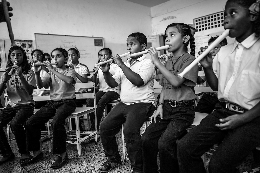 Children learn to play classical music during their first week of recorder class at the 23 de Enero nucleo, of the El Sistema music program. 23 de Enero slum is the stronghold of late socialist President, Hugo Chavez. It is where his armed, militant supporters live, and is indisputedly the heart of the Revolution in Venezuela.