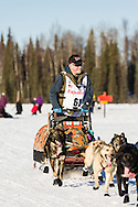 Musher Jeff King competing in the 44th Iditarod Trail Sled Dog Race on Long Lake after leaving the restart on Willow Lake in Southcentral Alaska.  Afternoon. Winter.
