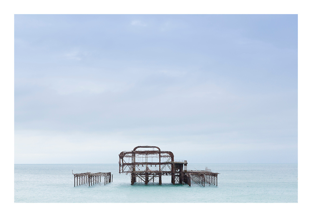 Brighton's dilapidated yet hauntingly beautiful West Pier, Sussex. View from the deck underneath the Brighton i360 tower.    //   High quality prints are available from &pound;23, with a choice of sizes and finishes. Print dimensions match readily available frames. For larger prints, we recommend professional mounting and framing. Multiple prints of similar size share one delivery charge, and next day delivery is available on orders placed before 1pm. Christmas deadline - 22nd December 2016. Full money-back guarantee if you're not happy for any reason.   //   <br />