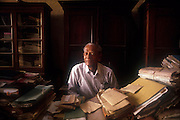 A lawyer sits in his office in the Galle Fort, Galle. A world Heritage Site..