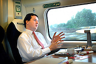 George Osborne MP, Chancellor of The Exchequer, during a visit to Manchester. Photo shows him traveling First Class on the 7.35am train from London Euston to Manchester Piccadilly.