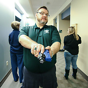 EMT Rob Dusty Sweetman (CENTER) carrying a replica handgun while participating in a unknown threat location scenario in the course of an Active Shooter workshop Sunday, Mar 16, 2014 Christina Hospital in Newark Delaware.