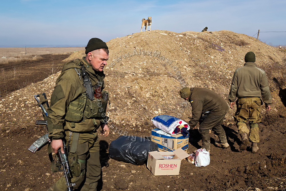 The Commander of the 54th Mechanised Brigade of the Ukrainian army (left) is overlooking the delivery of supplies to his positions on the frontline in Myronivs'kyi, eastern Ukraine.