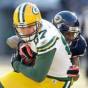 .Green Bay Packers' Jordy Nelson is tackled by Chicago Bears' Tim Jennings after a 1st quarter reception. .The Green Bay Packers traveled to Soldier Field in Chicago to play the Chicago Bears in the NFC Championship Sunday January 23, 2011. Steve Apps-State Journal.