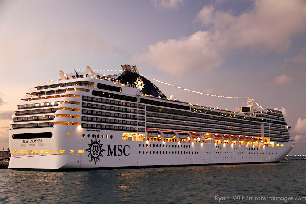 MSC Poesia lit up at dusk.