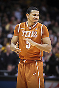 SHOT 2/26/11 5:06:38 PM - Colorado's  Texas' Cory Joseph (#5) reacts after missing a free throw against Colorado during their regular season Big 12 basketball game at the Coors Events Center in Boulder, Co. Colorado upset the fifth ranked Texas 91-89. (Photo by Marc Piscotty / © 2011)