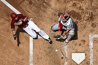 PHOENIX, AZ - May 13: D-backs infielder Chris Owings safely slides in to score against Nationals catcher Jose Lobaton during the second inning. (Photo by Jennifer Stewart/Arizona Diamondbacks)