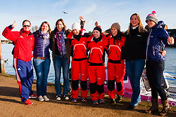 Marlow, Bucks, January 24th 2015. Olympic and Paralympic rowing medallists including Naomi Riches, Heather Stanning and Katherine Grainger join members of a Coxless Crew at Marlow at their boat naming ceremony. The Coxless Crew is a team of four women who have given up their jobs to undertake an epic six-month 8,446 mile adventure rowing their boat Doris across the Pacific ocean from Sanfrancisco to Cairns in Australia, to raise funds for charities Walking With The Wounded and Breast Cancer Care. PICTURED: The Coxless Crew in red are joined by rowing luminaries Naomi Riches, left, Katherine Grainger, third from left, and Heather Stanning, right.