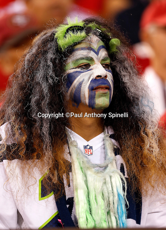 A Seattle Seahawks fan with a wild wig and painted face looks on during the NFL week 7 football game against the San Francisco 49ers on Thursday, Oct. 18, 2012 in San Francisco. The 49ers won the game 13-6. ©Paul Anthony Spinelli